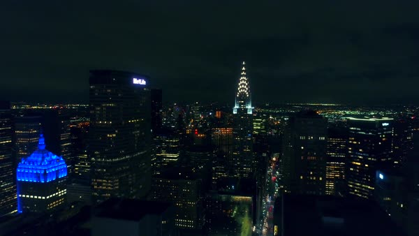 Wide aerial shot of the Chrysler Building building in New York City at night Royalty-free stock video