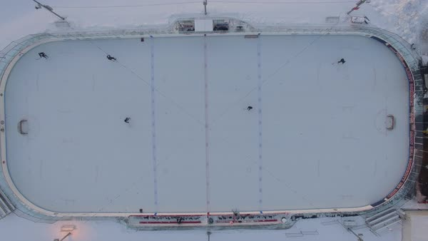 Drone shot of ice hockey players practicing on an outdoor ice rink Royalty-free stock video