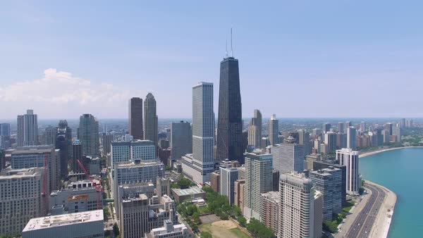 Aerial shot of skyscrapers in downtown Chicago seen from above Lake Michigan Royalty-free stock video