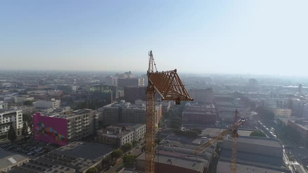 Aerial shot of a Los Angeles skyscraper with a crane machine on construction site  Royalty-free stock video