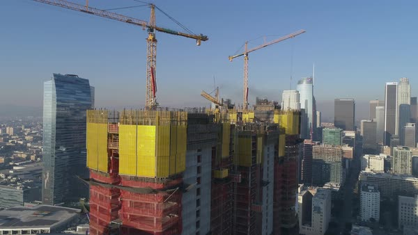 View of a building under construction and a Los Angeles skyscraper with cityscape in background  Royalty-free stock video