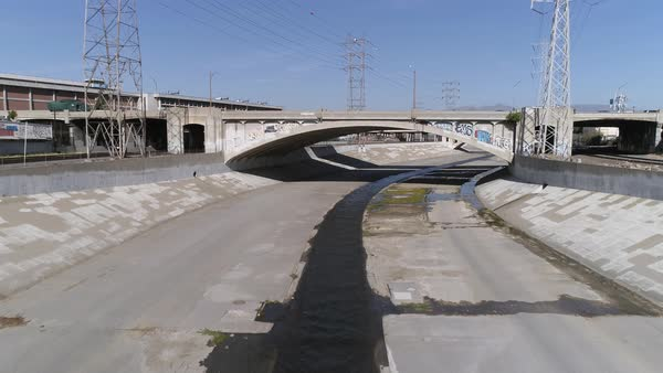 Vehicle moving on bridge over Los Angeles River Royalty-free stock video