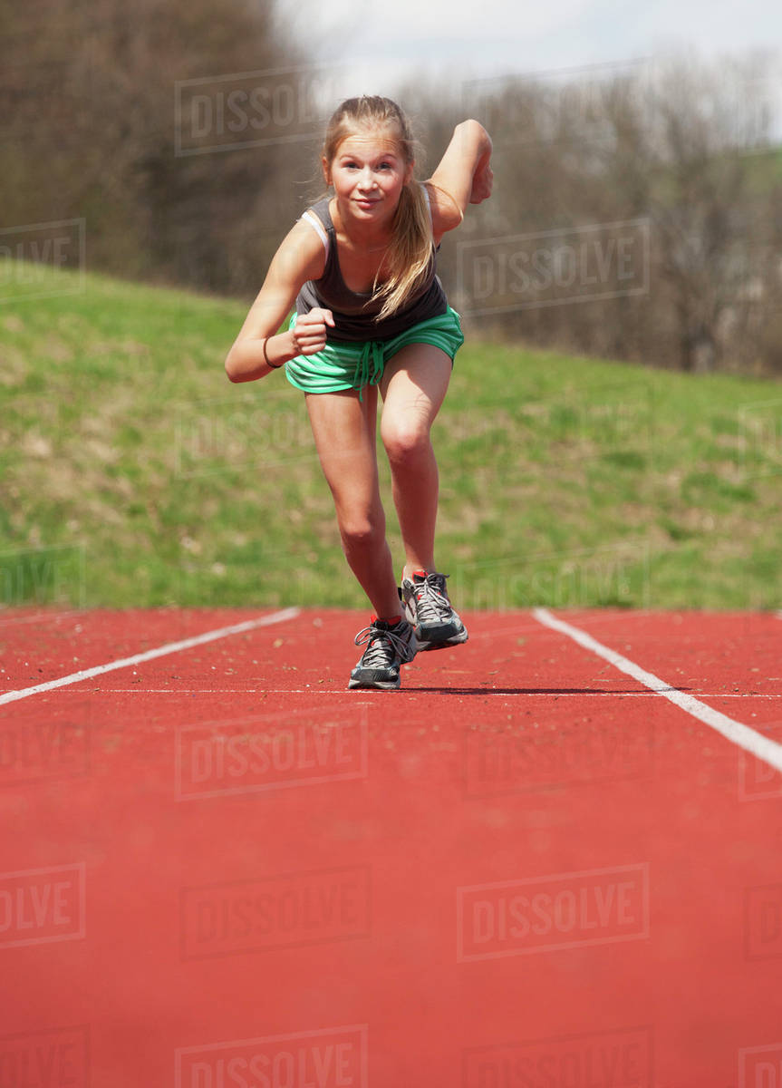 austria teenage girl running on track portrait stock photo