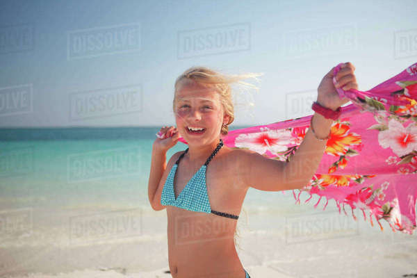 Tanzania, Zanzibar Island, portrait of girl with cloth at seafront Rights-managed stock photo