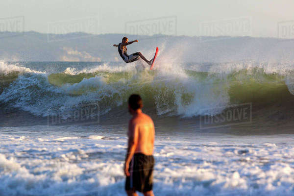 Indonesia, Bali, Surfing a wave Rights-managed stock photo