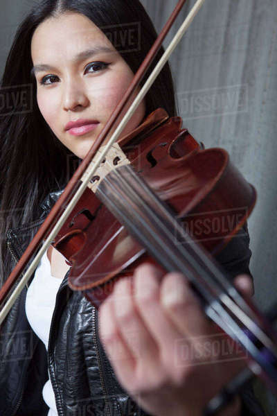 Portrait of young female Asian violinist Rights-managed stock photo