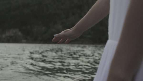 Handheld shot showing a woman holding her hand over water surface Royalty-free stock video