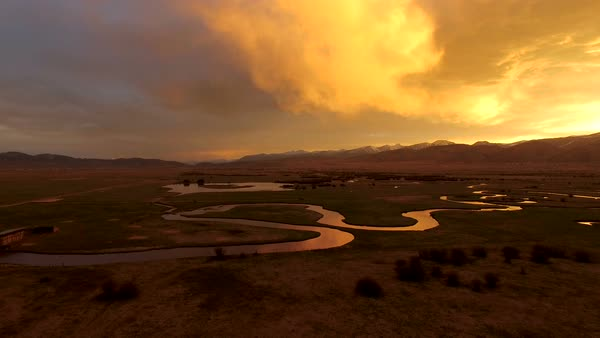 Flying over river at golden sunrise in Wyoming Royalty-free stock video