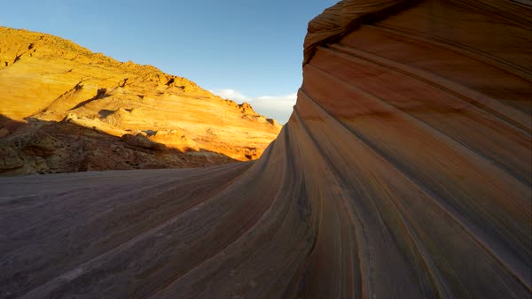 Hiking in the desert of Coyote Buttes North, The Wave area. Gliding over the sandstone and stripes in the rock. Royalty-free stock video
