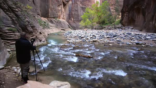 View of Photographer taking picture in the Zion Narrows Royalty-free stock video