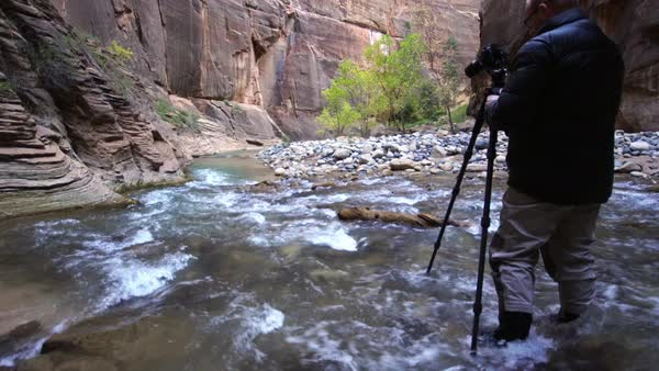 Photographer shooting down stream in the Zion Narrows Royalty-free stock video