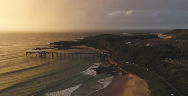 Catherine Hill Bay aerial view with gentle waves washing onto sandy beach near pier in New South Wales Australia Royalty-free stock video
