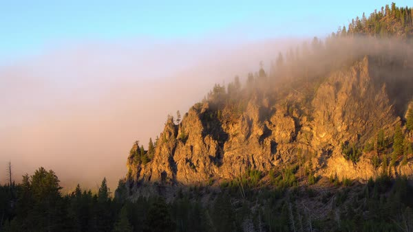 Yellowstone misty sunrise shining on mountain side Royalty-free stock video