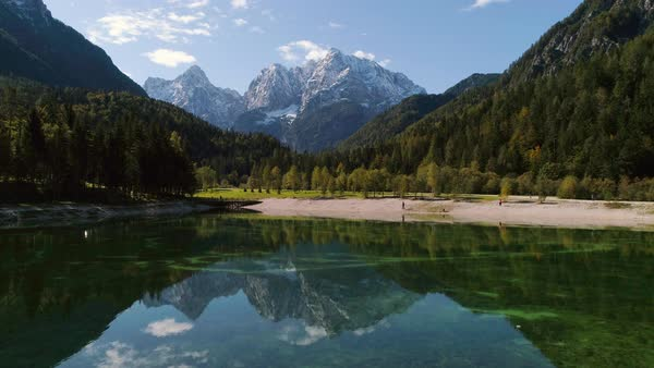 Jasna Lake aerial view showing reflection of mountain peaks Royalty-free stock video