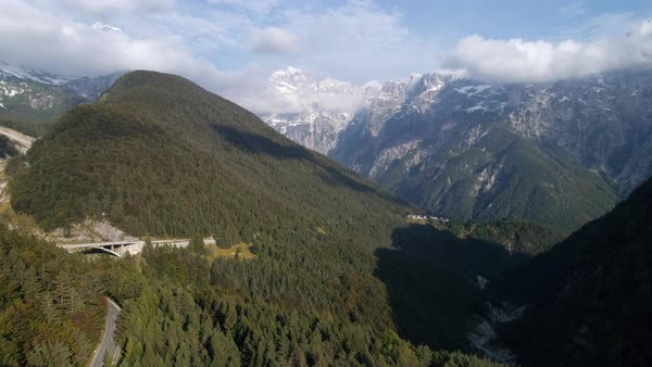 Aerial view high above the mountains and forest near Predil Pass Slovenia viewing the Julian Alps. Royalty-free stock video