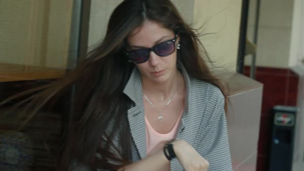 6c65883a4d Beautiful girl with sunglasses siting in street cafe Royalty-free stock  video