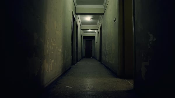 Pov walk on the corridor of an old apartment buildinglong and tracking in on the long dark corridor of an old urban apartment building royalty sciox Images