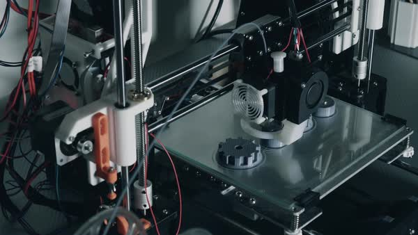 3D printer printing industrial objects out of plastic filament Royalty-free stock video