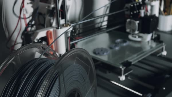 3D printer printing using a spool of plastic filament Royalty-free stock video