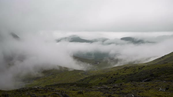 Cuillin Hills, Isle of Skye, Scotland. Coire a' Ghreadaidh Valley. Timelapse of the morning fog rising above the hills revealing Brittle Valley. Royalty-free stock video