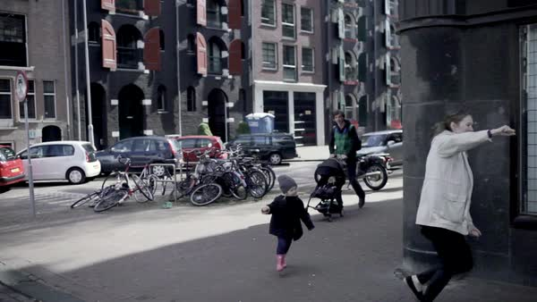Full shot of a family walking on the streets of Amsterdam Royalty-free stock video