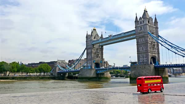 Stop motion of the famous London red bus toy passing by Tower Bridge, part 1 Royalty-free stock video