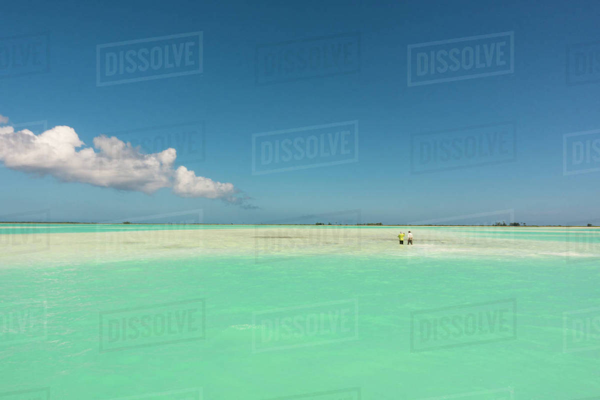 Azure blue waters of the coral lagoon at Kiribati / Christmas Island ...