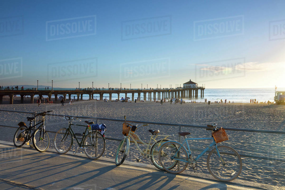 Parked Bicycles Leaning On Railing At Manhattan Beach Los Angeles California Usa Stock Photo Dissolve