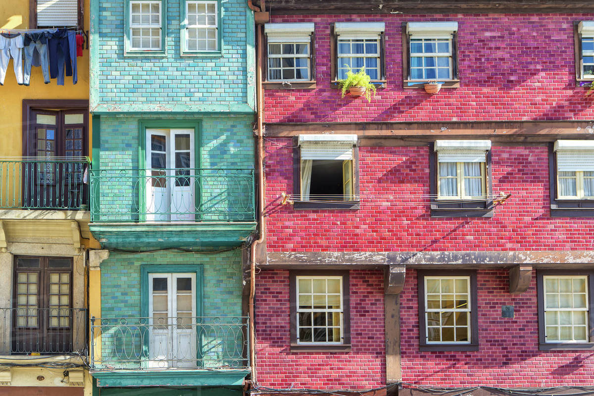 Windows and balconies of colorful terrace houses, Porto, Portugal ...