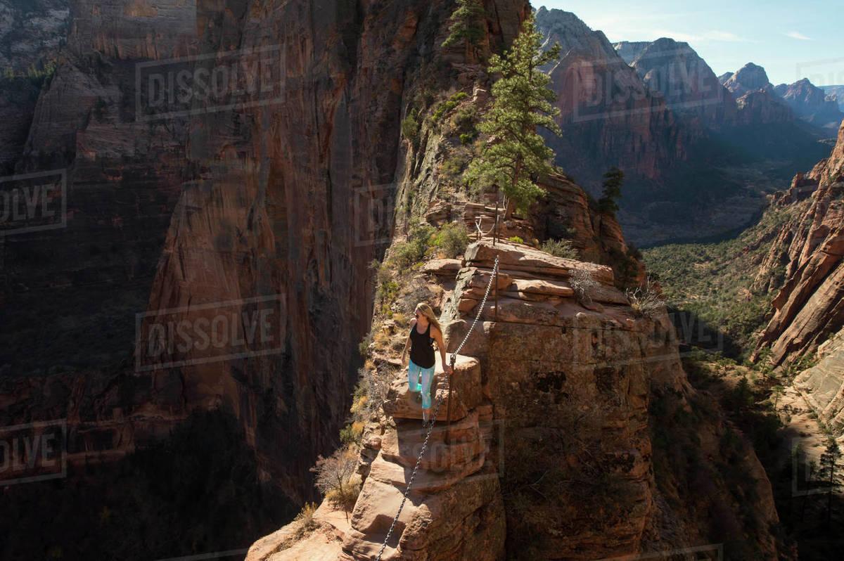 young woman hiking at angels landing zion national park utah usa