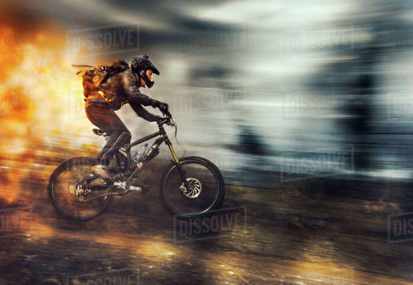 Fast passage of a mountain biker  Royalty-free stock photo
