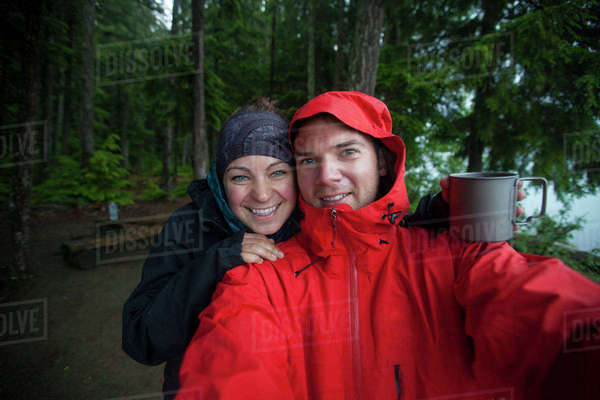 A couple take a selfie  on a wet day while camping in Bowron Lake Provincial Park. Royalty-free stock photo