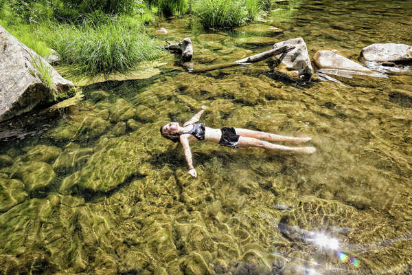 Girl Floats Peacefully In The West Clear Creek, Coconino National Forest, Arizona Royalty-free stock photo