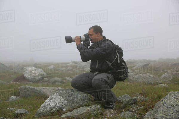 Male Photographer Taking Picture Of Mount Washington During Heavy Cloud Coverage Royalty-free stock photo