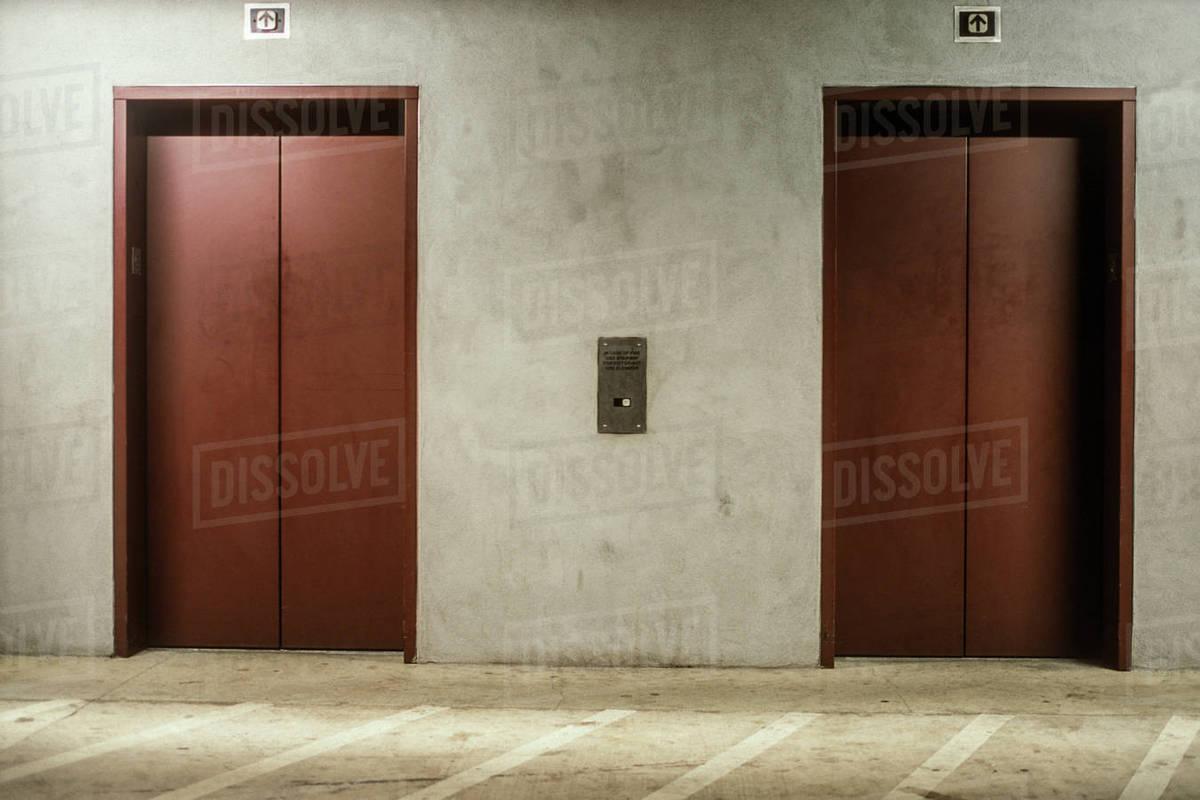 Two closed elevator doors & Two closed elevator doors - Stock Photo - Dissolve