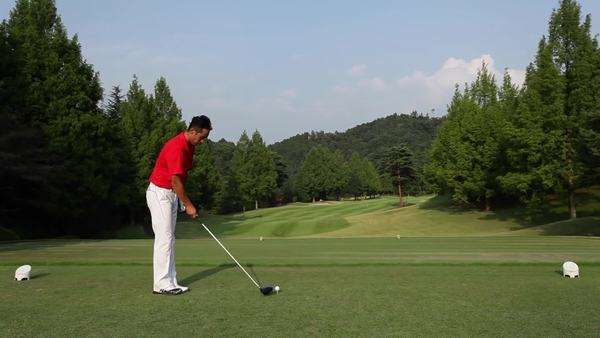 Male golf player hitting tee shot Royalty-free stock video