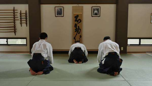 Athletes Performing Aikido Training In A Traditional Dojo Stock
