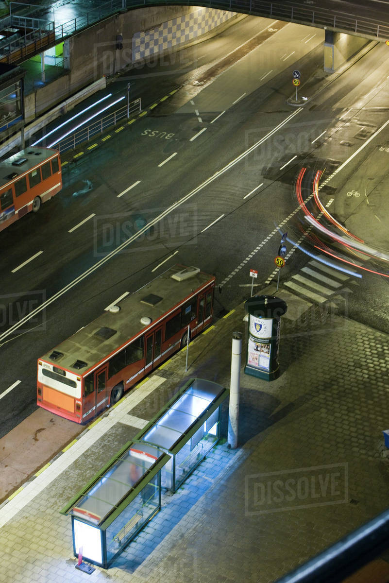 Sweden, Stockholm, bus waiting by bus stop at night, high angle view stock  photo