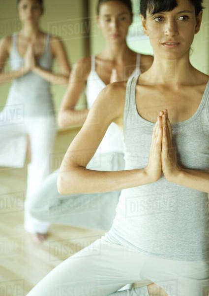 Yoga class doing tree pose Royalty-free stock photo