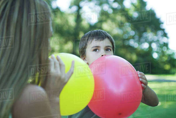 Boy and mother blowing up balloons Royalty-free stock photo