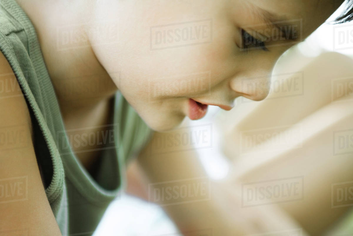 Little boy, side view of face, looking down, cropped Royalty-free stock photo