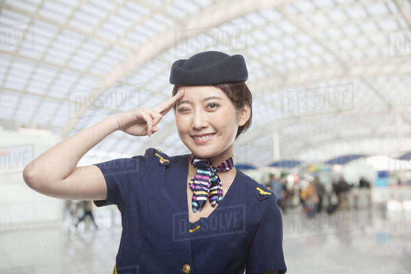 Portrait of Air Stewardess Winking Royalty-free stock photo