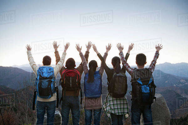 Group of people standing with hands outstretched Royalty-free stock photo