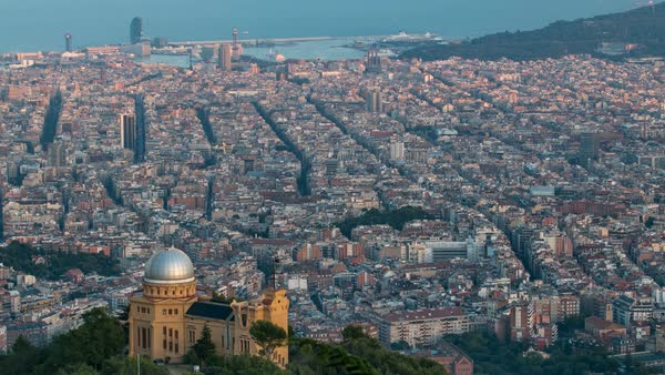 Panorama of Barcelona timelapse with palace on hill from Mount Tibidabo before sunset. Catalonia, Spain. Shadow move over the city. Royalty-free stock video