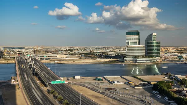 Business bay crossing bridge timelapse, 13-lane-bridge, over the Dubai Creek, opened in March 2007. Blue cloudy sky before sunset Royalty-free stock video
