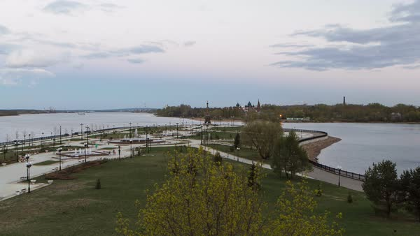 View of the city park strelka in Yaroslavl located along the Volga river embankment day to night transition timelapse hyperlapse, a popular local and touristic landmark. Royalty-free stock video
