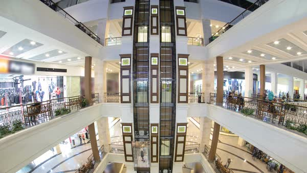Motion elevators at the modern shopping mall timelapse hyperlapse. A multi-storey shopping center Royalty-free stock video