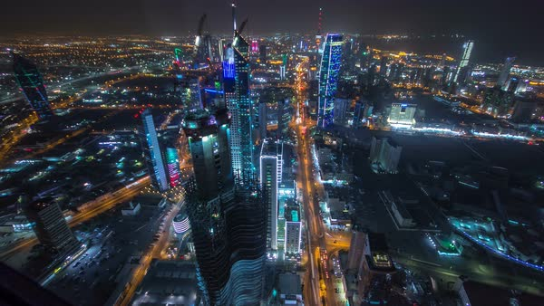 Skyline with Skyscrapers night timelapse in Kuwait City downtown illuminated at dusk. Kuwait City, Middle East. View from rooftop with foggy weather Royalty-free stock video