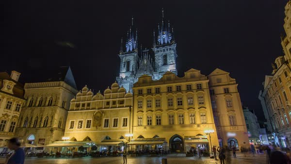 Night time illuminations of the magical Old Town Square timelapse hyperlapse in Prague, visible are Kinsky Palace and the fairytale gothic towers of the Church of Our Lady Tyn (1365). Royalty-free stock video