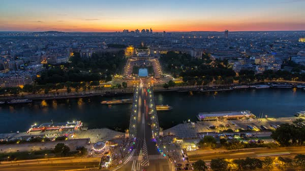 Aerial view over Trocadero day to night transition timelapse with the Palais de Chaillot seen from the Eiffel Tower in Paris, France. Top view from observation deck with river Seine and ship crossing it at summer day Royalty-free stock video